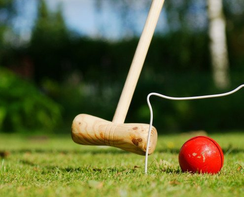 Learn how to play croquet - the classic outdoor game for family fun! Visit www.GameOnFamily.com for the croquet rules and a delightful croquet game tutorial. Game on!