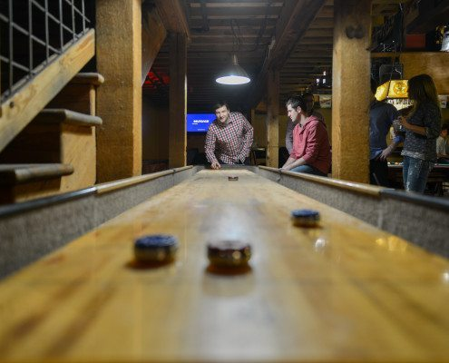 Curious to learn how to play shuffleboard? Check out www.GameOnFamily.com for shuffleboard rules for this classic game room game. Game on!